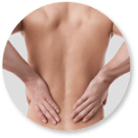 Image of person holding their lower back  due to lower back pain.